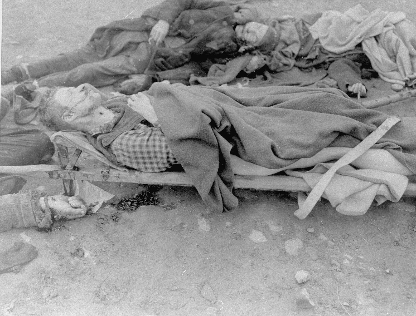 The bodies of prisoners shot in Ohrdruf during the evacuation of the camp, one of which has been placed on a stretcher.