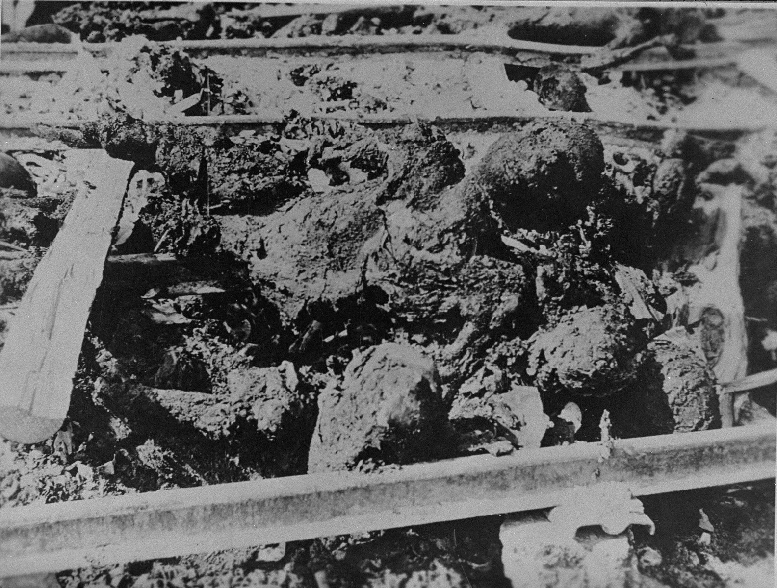 Partially burned corpses left by the hastily retreating Nazis.