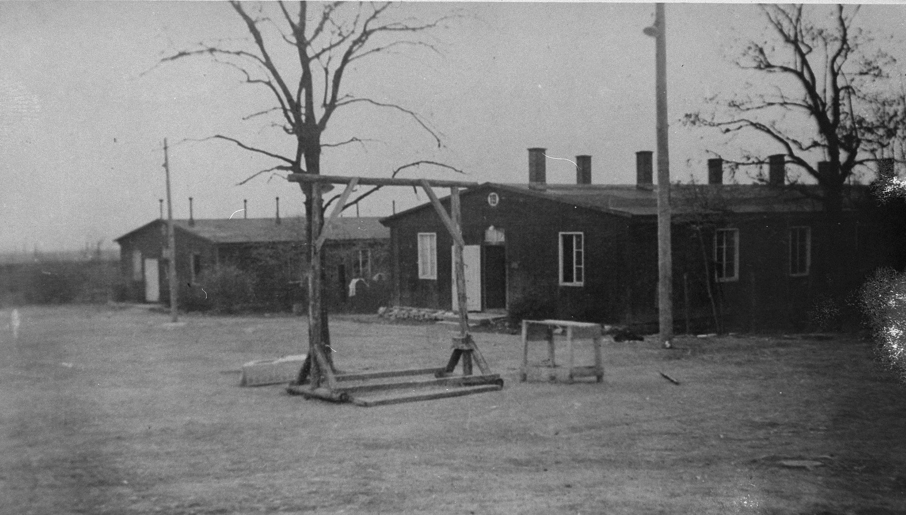 View of the gallows and barracks in the Ohrdruf concentration camp.