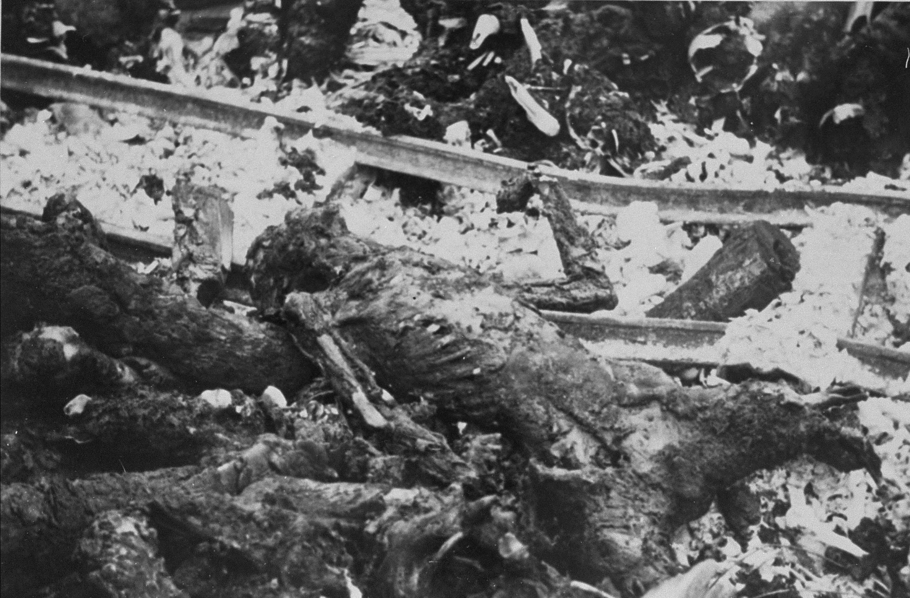 The charred corpses of prisoners burned by the SS prior to the evacuation of Ohrdruf.
