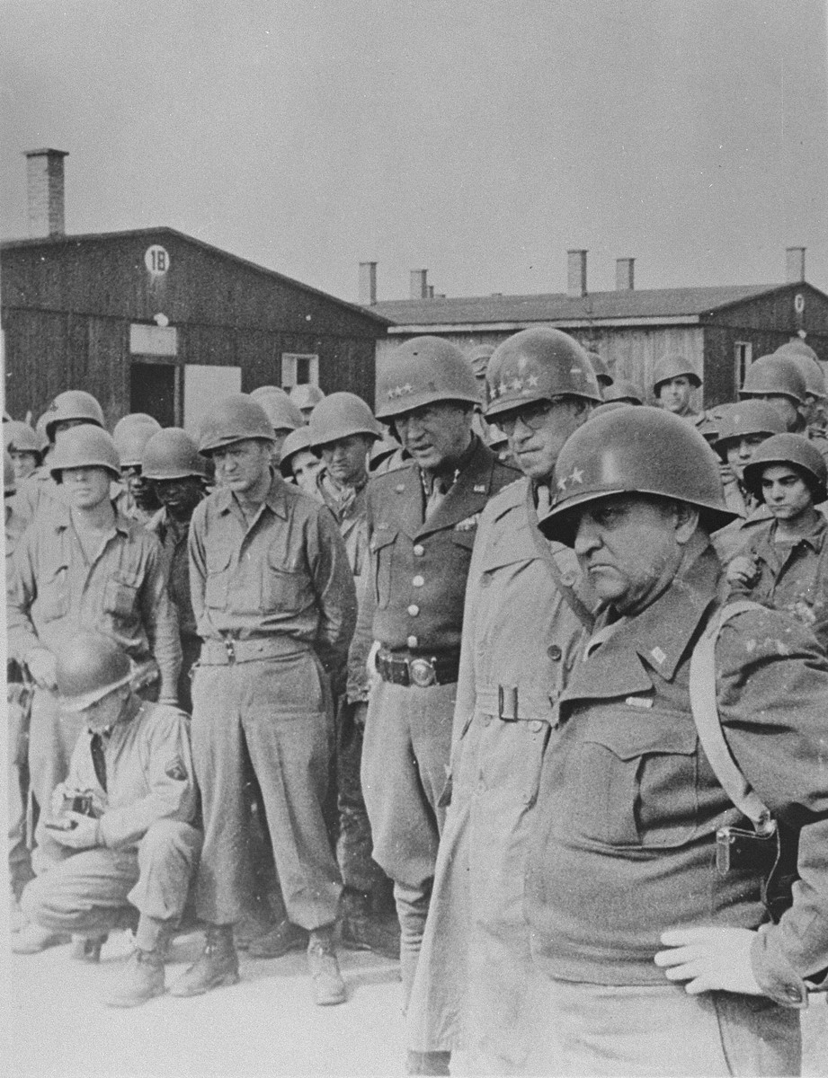 American generals tour the newly liberated Ohrdruf concentration camp.  Pictured from right to left are Generals Manton Eddy, Omar Bradley and George Patton.