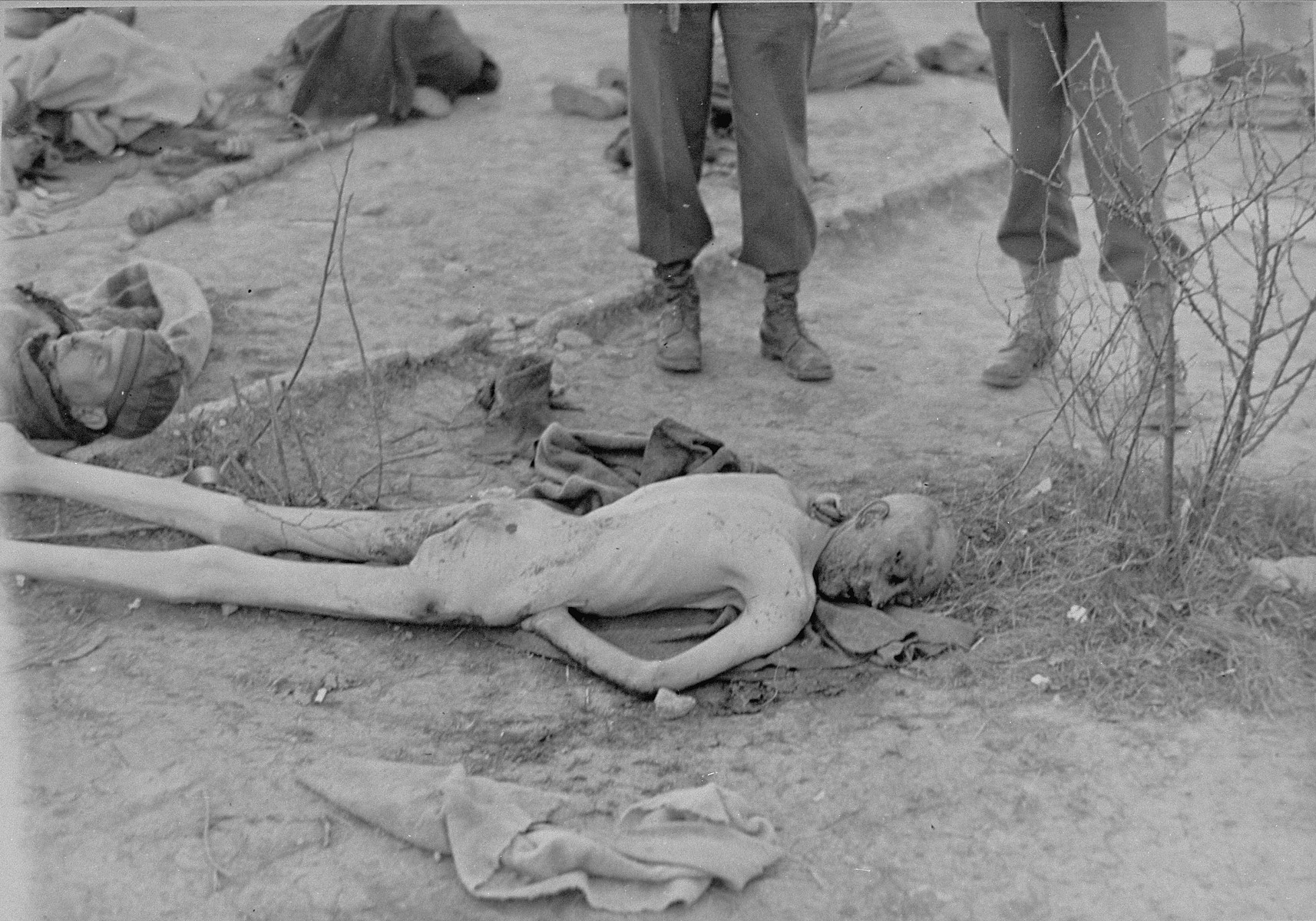 American soldiers view a naked, emaciated corpse in Ohrdruf.