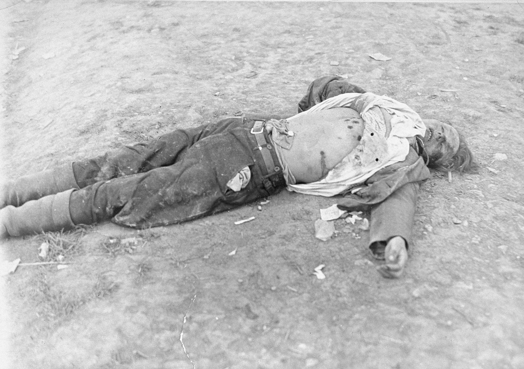The corpse of an SS guard who was killed by Soviet prisoners after the arrival of the American army at Ohrdruf.