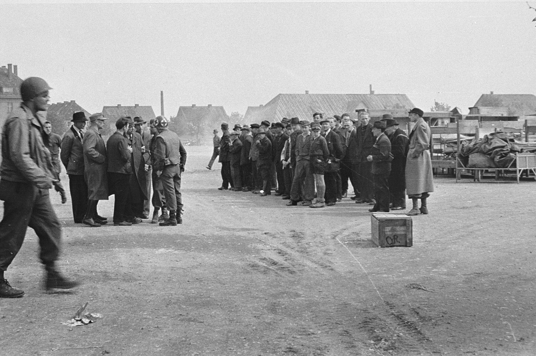 German civilians are assembled before being detailed to collect and bury the victims of the Langenstein-Zwieberge concentration camp.
