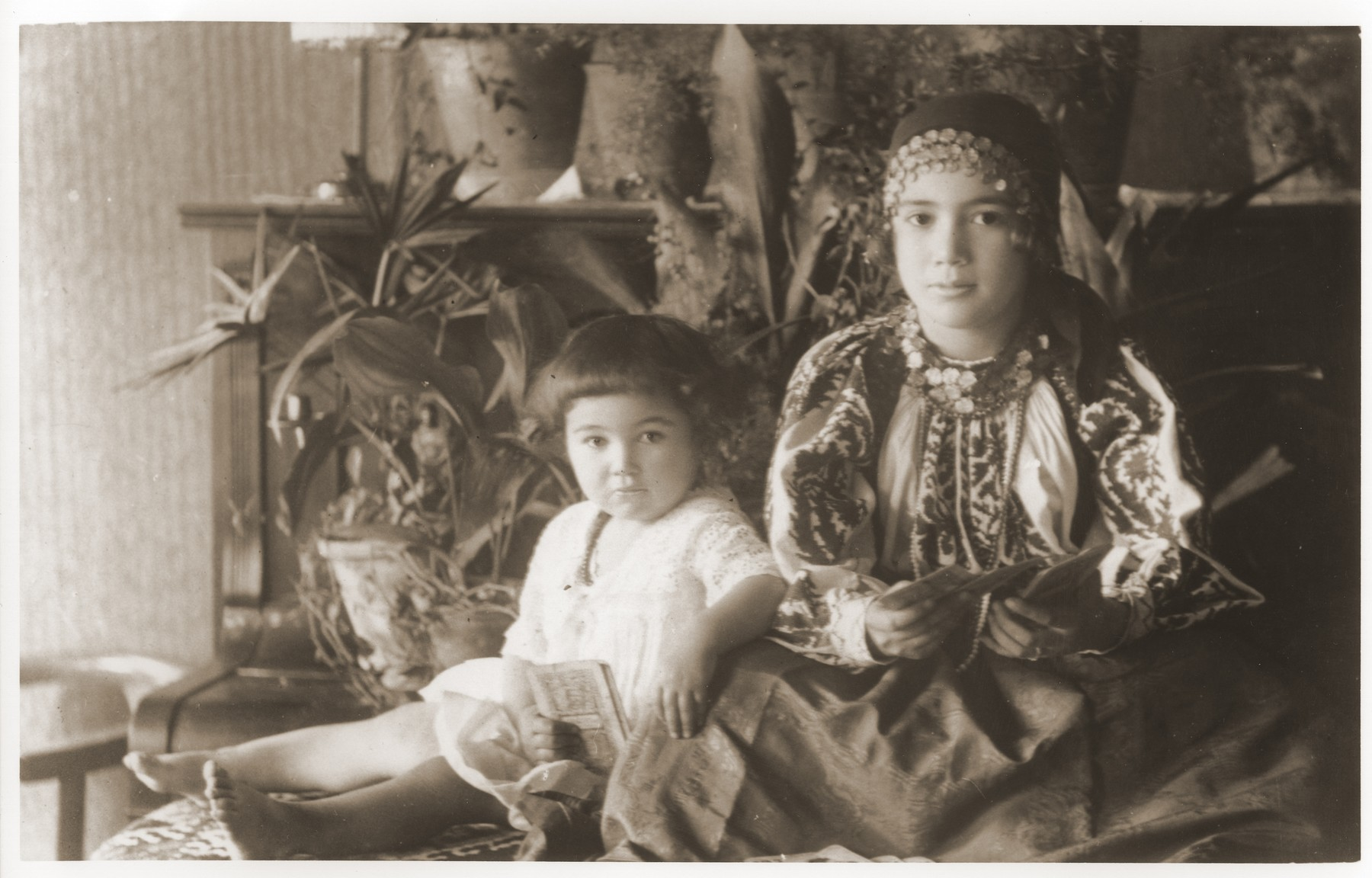 Two Jewish sisters pose at their home in Novi Knezevac, Yugoslavia.  Pictured are Magda and Olga Schiller, the cousins of the donor, Ivan Singer.