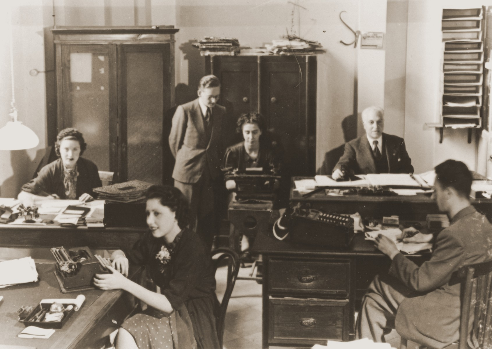 The staff of the Foto-Brenner company at work in their office in Rome.