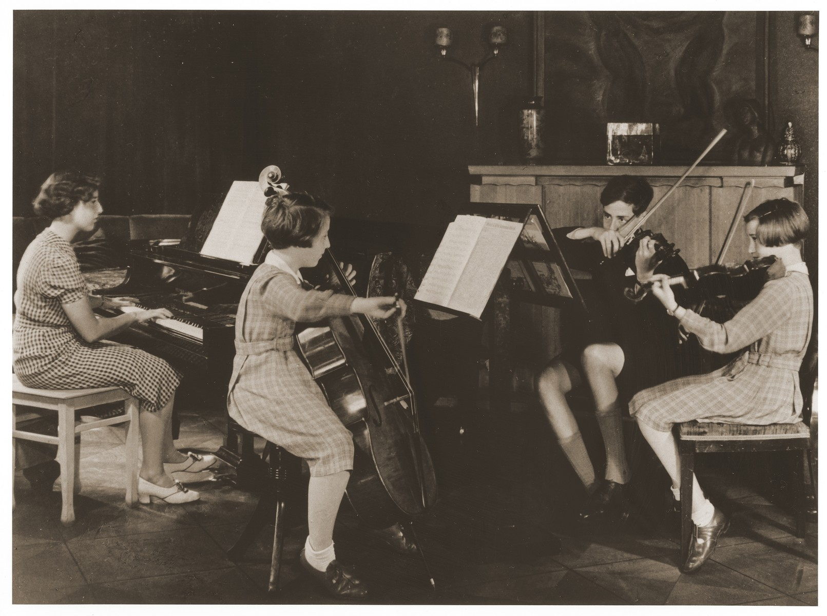 The Hess children play a quartet for strings and piano in their home in Hamburg.  Marion Hess is pictured at the piano.