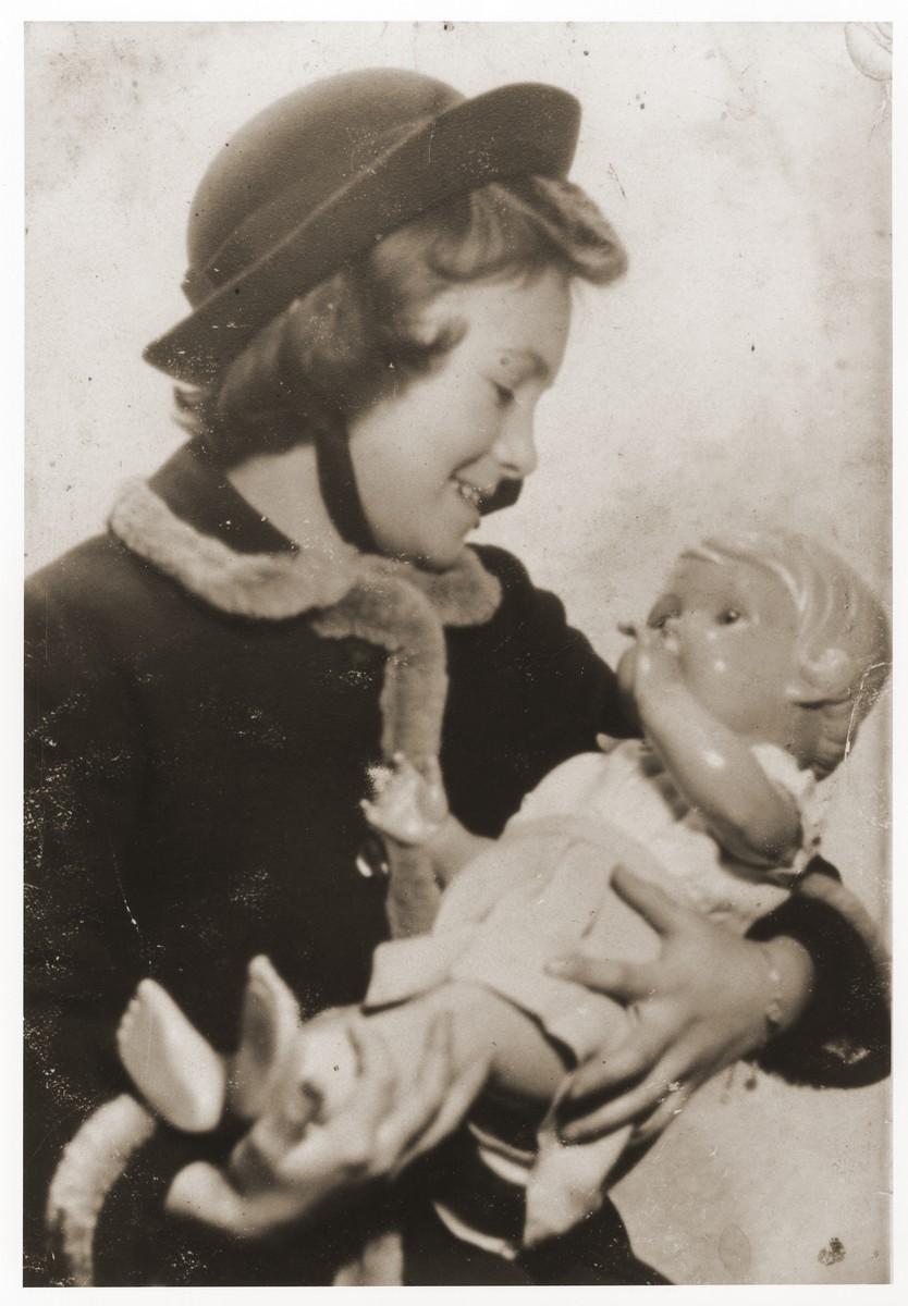 Dorothea Isaacsohn cradling her doll.