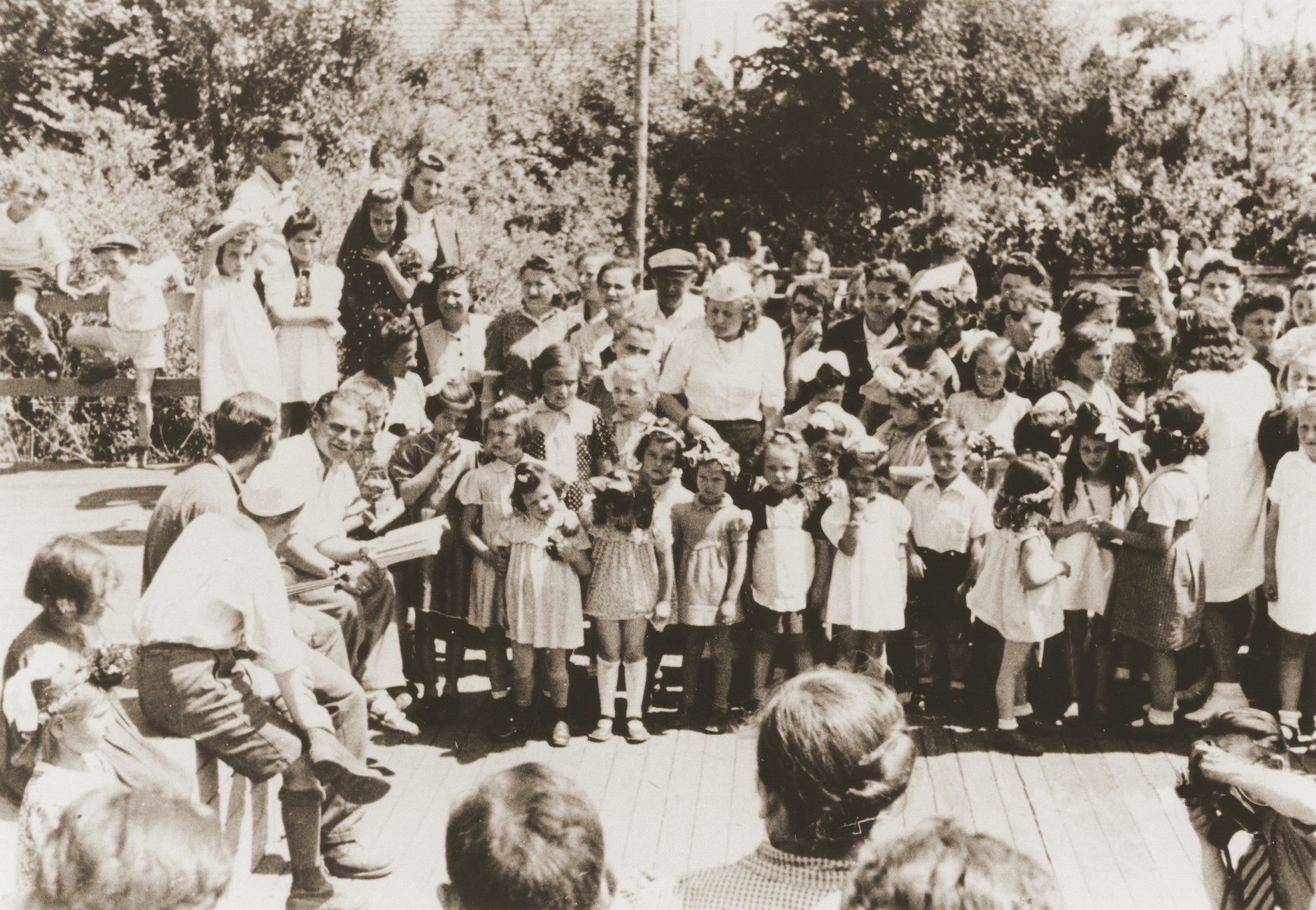 Kindergarten children in the Neu Freimann displaced persons camp give an outdoor performance.