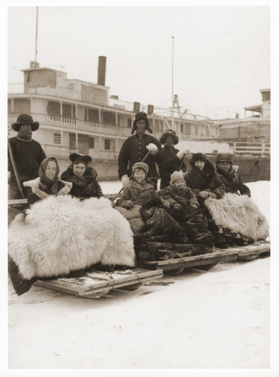 Jewish refugees on a sleigh ride in Harbin, China.  Among those pictured is Hellmut Stern (center).