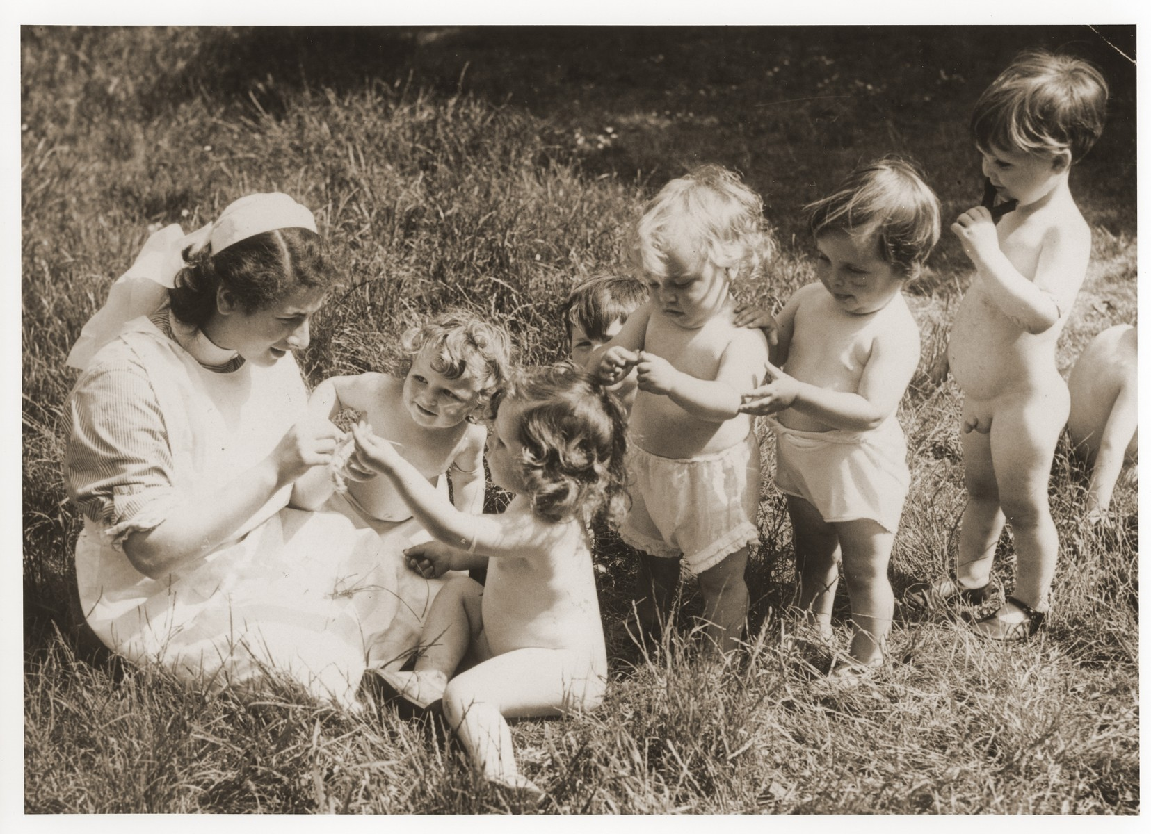 Ursel Glasfeld plays with a group of toddlers at a British nursery in Uxbridge.