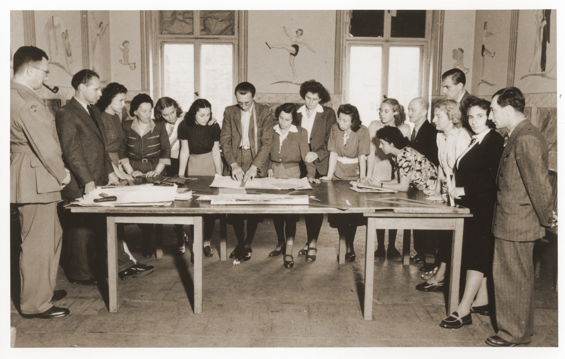 Dorthea and Gertrude Isaacsohn attend a dressmaking class at the ORT school in Berlin.  Dorthea and Gertrude are pictured third and fourth from the left.