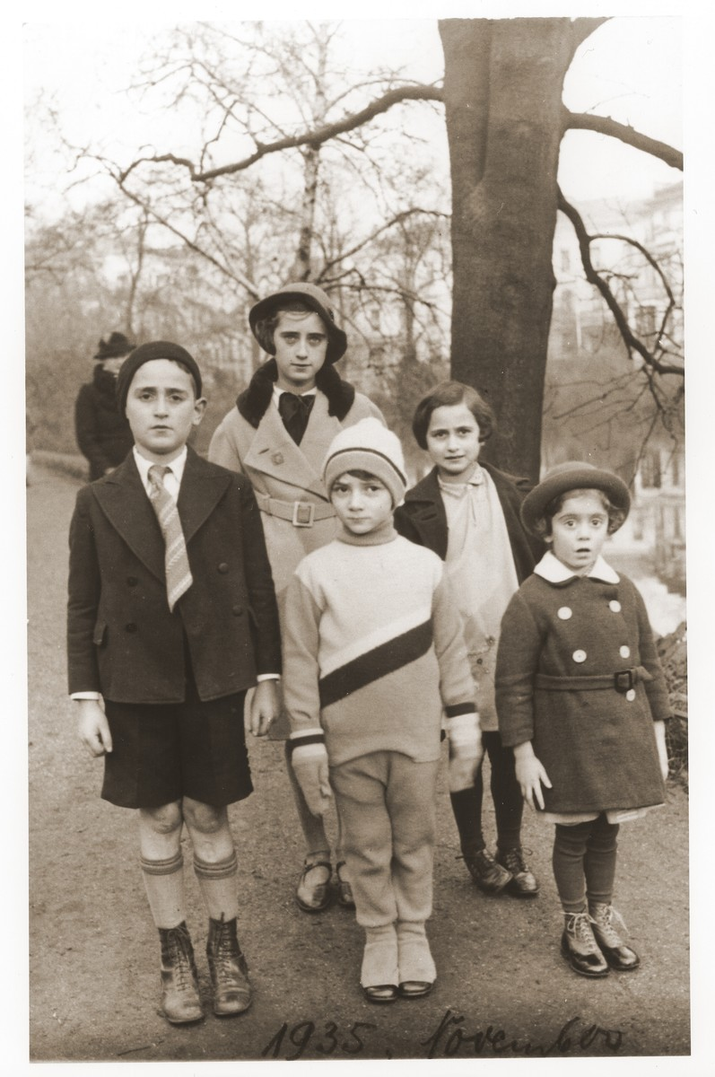 The Goldschmidt children pose in the park with their cousins.  Pictured in the front row, from left to right, are, Herbert Goldschmidt, Ursel Salamon, unknown.  Standing behind are Lotte and Inge Goldschmidt.