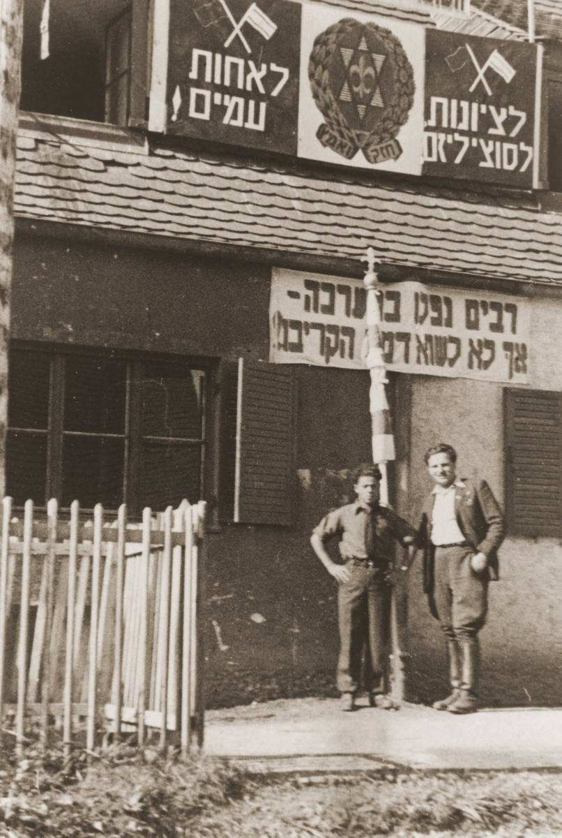 Izik Sutin and Mark Breslin stand outside the headquarters of the Hashomer Hatzair Zionist youth movement in the Foehrenwald displaced persons camp.
