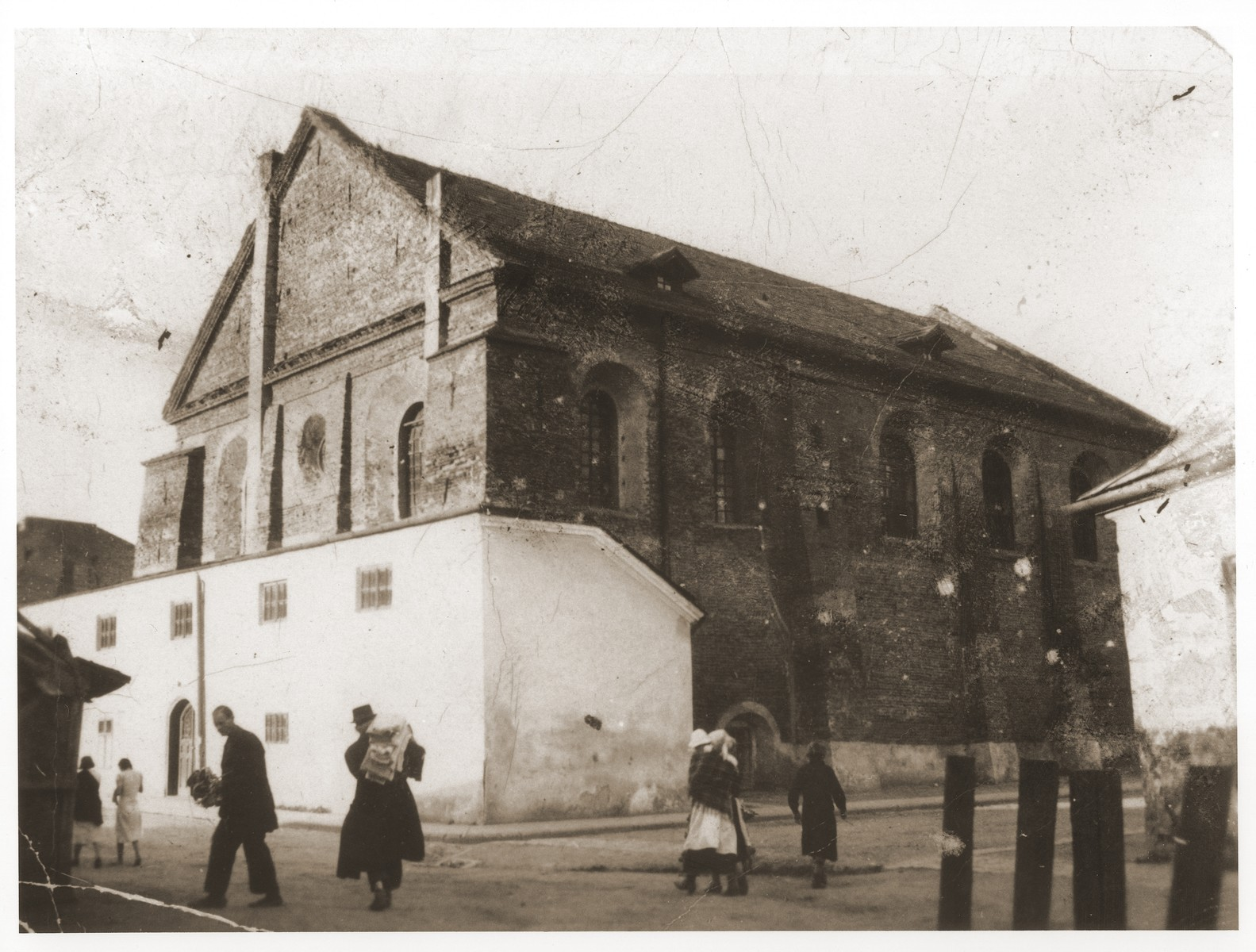 Jews walk along a street in front of the synagogue in Rzeszow, Poland.