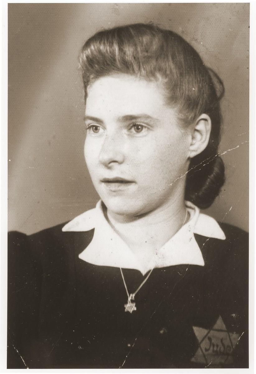 Portrait of Sara Kirschenbaum wearing a yellow star.