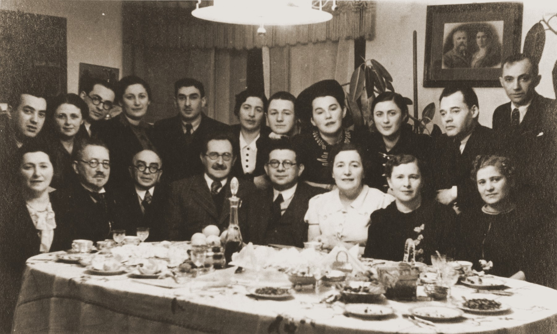 Dr. Aharon Pick hosts a dinner for the Jewish dramatist Nathan (Bistritski) Agmon, who is visiting from Palestine.  Dr. Pick is pictured seated, fourth from the left.  Haia Nudel (b.1928) is the daughter of Gitta and Leib Nudel of Siauliai, Lithuania, where Leib worked at the railway station.  Haia had two brothers, Mordechai (b.1930) and Yaakov (b.1933).  Soon after the German occupation of the city in the summer of 1941, Haia's father was killed.  The rest of the family was forced into the ghetto.  When her brother, Mordechai, attempted to escape, he was shot and killed.  The remainder of the family stayed in the ghetto until its liquidation in the summer of 1944.  At that time they were all deported to the Stutthof concentration camp.  Only Haia survived.  After the war, Haia made her way to Germany, where she lived for a time in the Foehrenwald DP camp.  In the fall of 1946, she joined a group of would-be immigrants to Palestine who attempted to run the British blockade aboard the Latrun.  The ship, however, was intercepted and its passengers deported to Cyprus.  Haia spent nine months in Cyprus detention camps before being allowed to enter Palestine in May, 1947.  David Pick (b.1922) is the son of Deborah Tatz and Dr. Aharon Pick of Siauliai, Lithuania.  In addition to his medical practice, David's father was active in Jewish cultural life.  The family hosted many visiting Jewish cultural figures.  During the war David's father succumbed to illness while living in the Siauliai ghetto.  His mother survived the ghetto but perished in the Stutthof concentration camp.  David managed to flee the ghetto shortly before its liquidation.  He was hidden by a Lithuanian priest for three weeks before the area was liberated.  After the war David became a guide for the Bricha, leading groups of Jewish survivors on routes to the west.  David immigrated to Palestine in 1948.  There, he met Haia Nudel and the two were married in 1949.