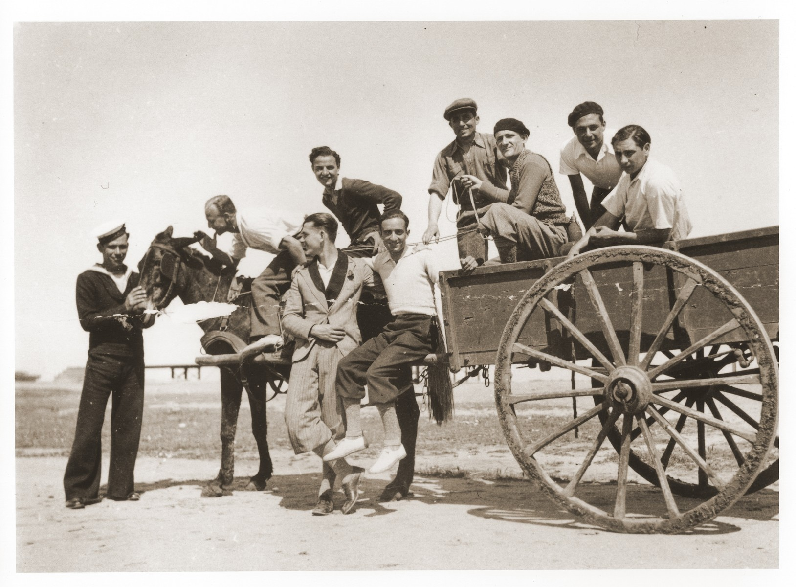 Sam Rouben (in the white shirt) poses with a group of friends on a horse-drawn wagon.
