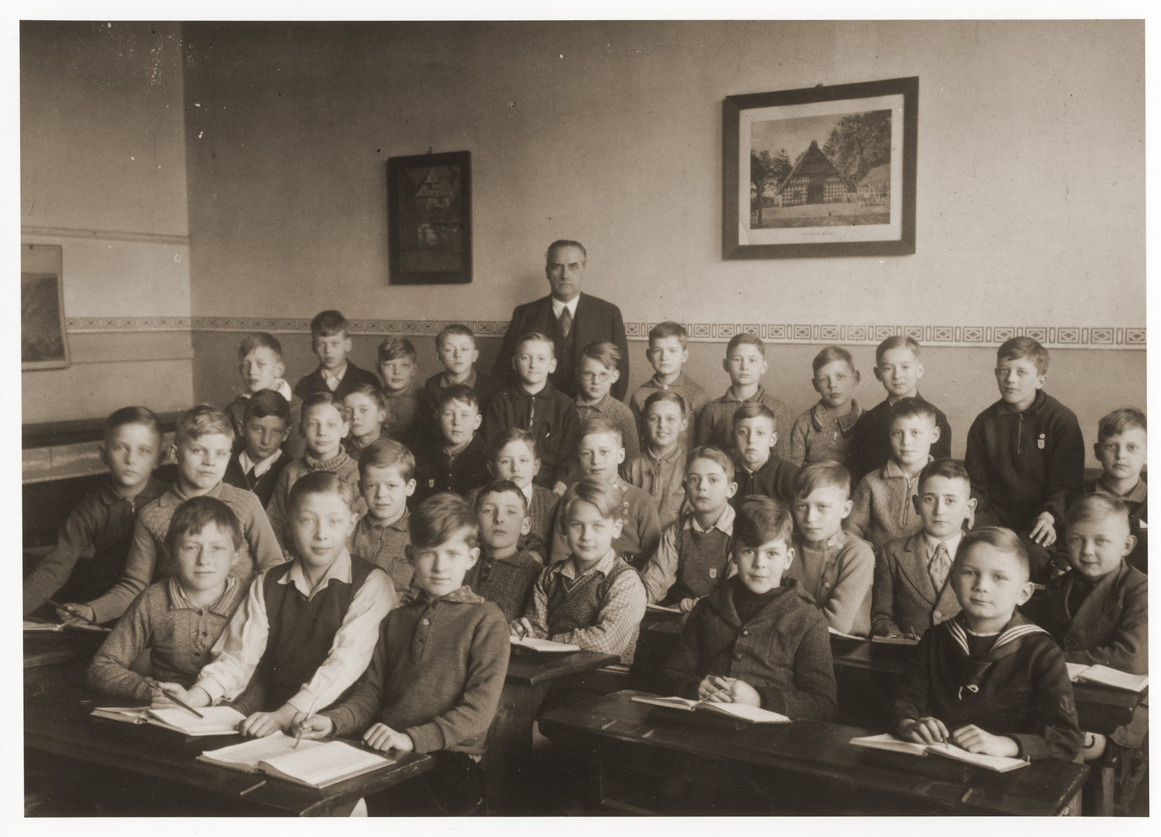 Herbert Goldschmidt sits in his classroom in Michaelschule, where he was the only Jewish child.  Herbert Goldschmidt is pictured in the third row from the front, second from the right.