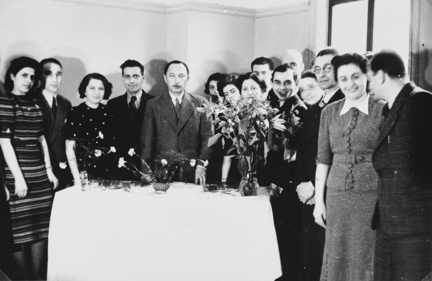 Paul Komor (center with the moustache) poses with fellow I.C. members at a festive gathering of the International Committee for European Immigrants in Shanghai.  One photograph from a second International Committee album prepared for I.C. secretary Paul Komor.