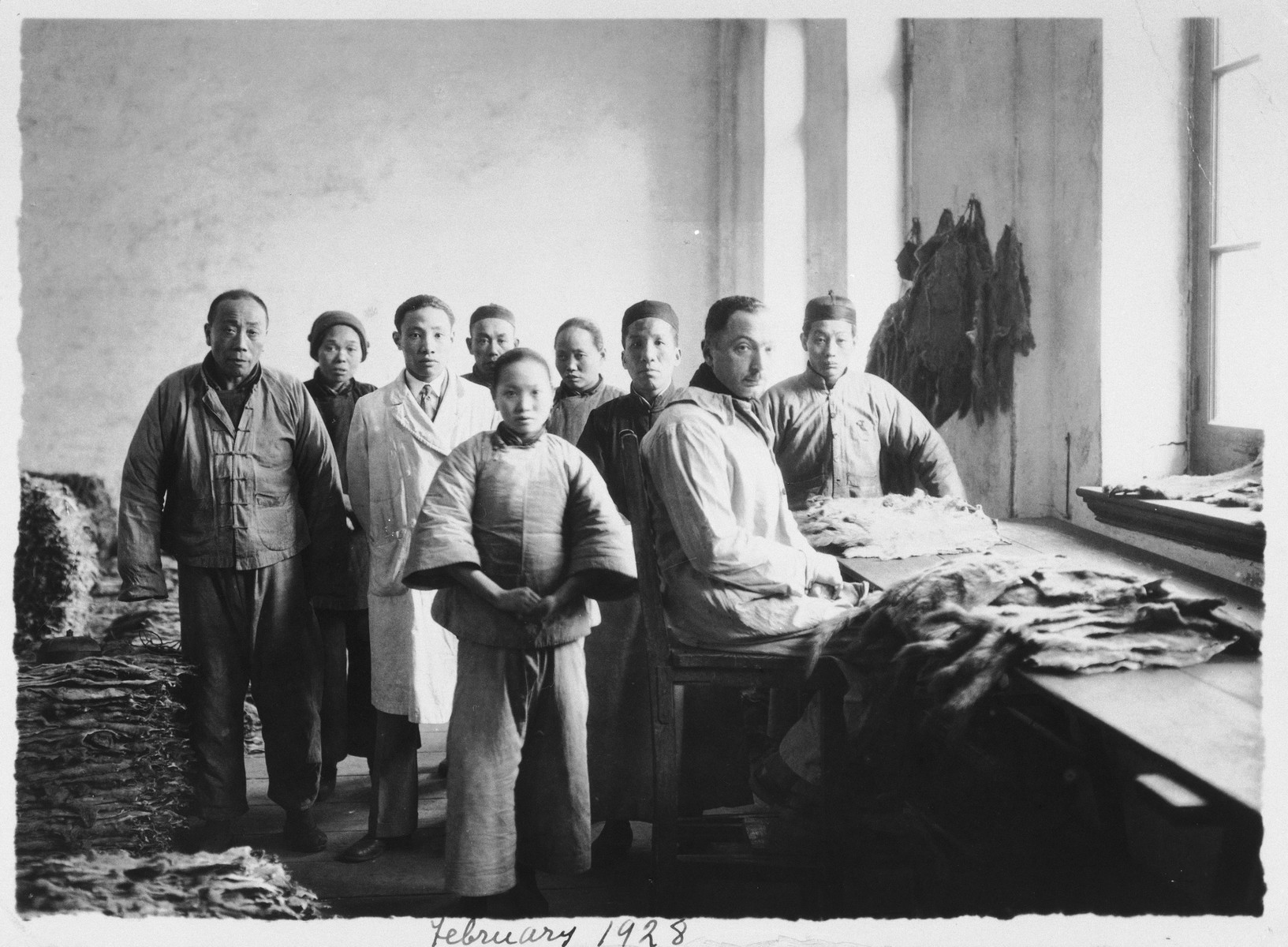 Paul Komor poses with a group of Chinese employees at a tannery in Shanghai.