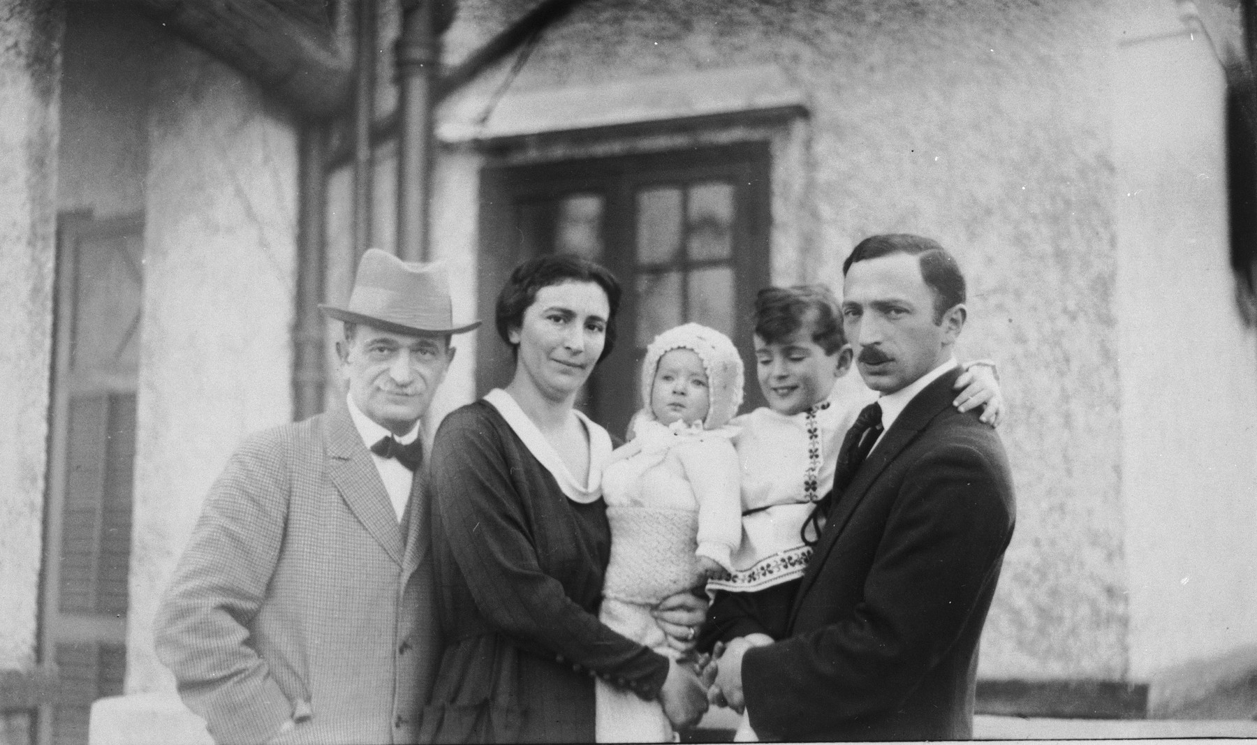 Portrait of the Komor family in Shanghai.    Pictured from left to right are Isidor, Adele, Peter, Leonard and Paul Komor.