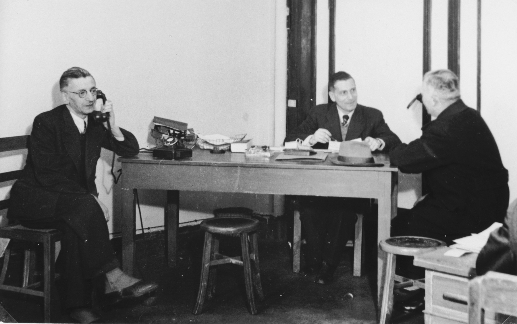 Members of the International Committee for European Immigrants in Shanghai at work in their office at the Cathay Hotel.  One photograph from a second International Committee album prepared for I.C. secretary Paul Komor.