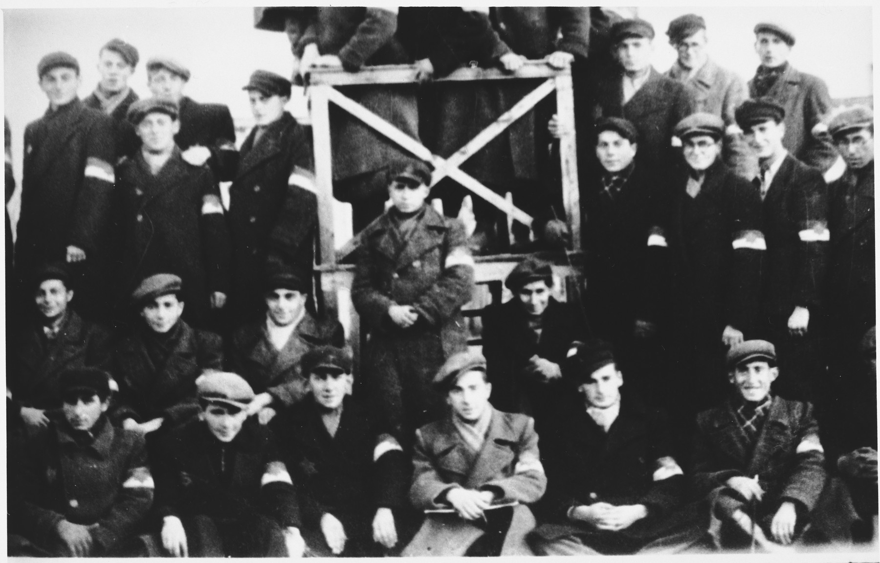 Group portrait of Jewish firefighters or police in the Lodz ghetto.