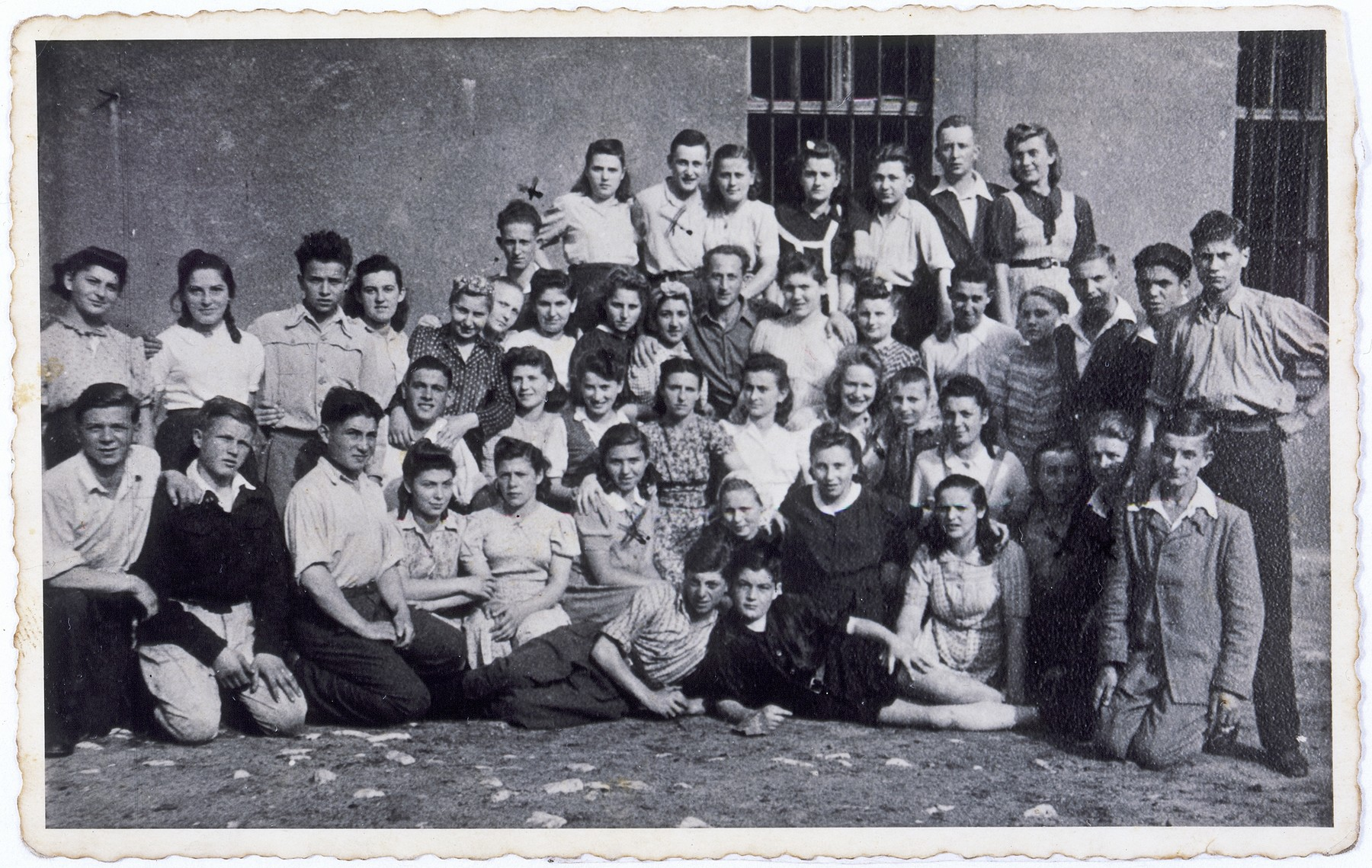 Group portrait of the members of a Shomer Hatzair kibbutz hachshara (Zionist collective) in Sosnowiec, Poland.  Among those pictured is Hela Kolin, top row, third from the left.