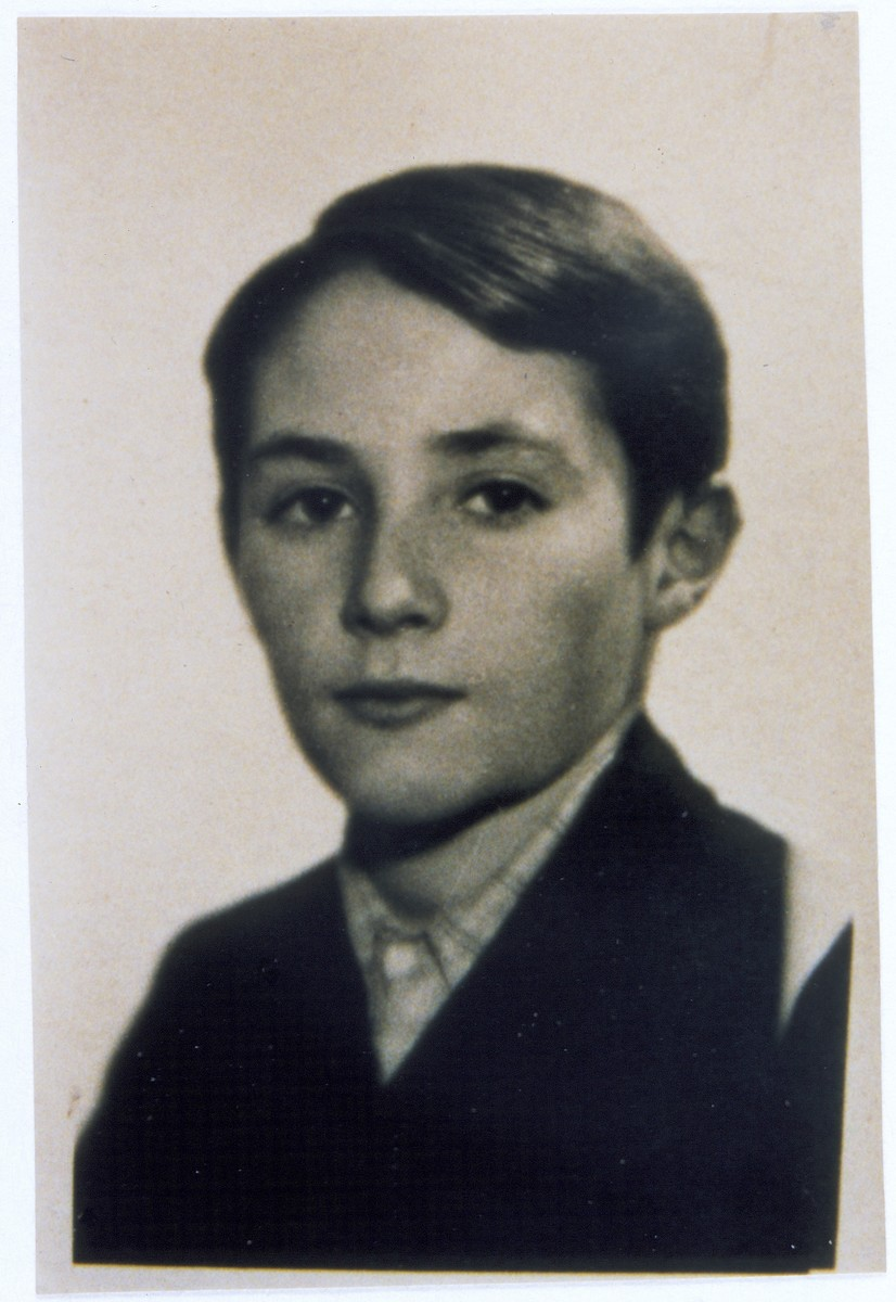 Identification card portrait of Jurek Orlowski taken in the Warsaw ghetto.  The photograph was taken by a Jewish photographer in the ghetto who specialized in taking photos specifically in preparing false IDs.