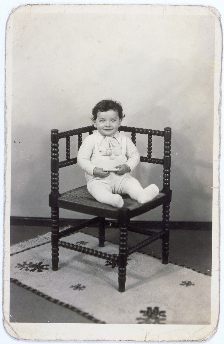 Portrait of Tswi Herschel seated in a chair, taken while he was living in hiding.