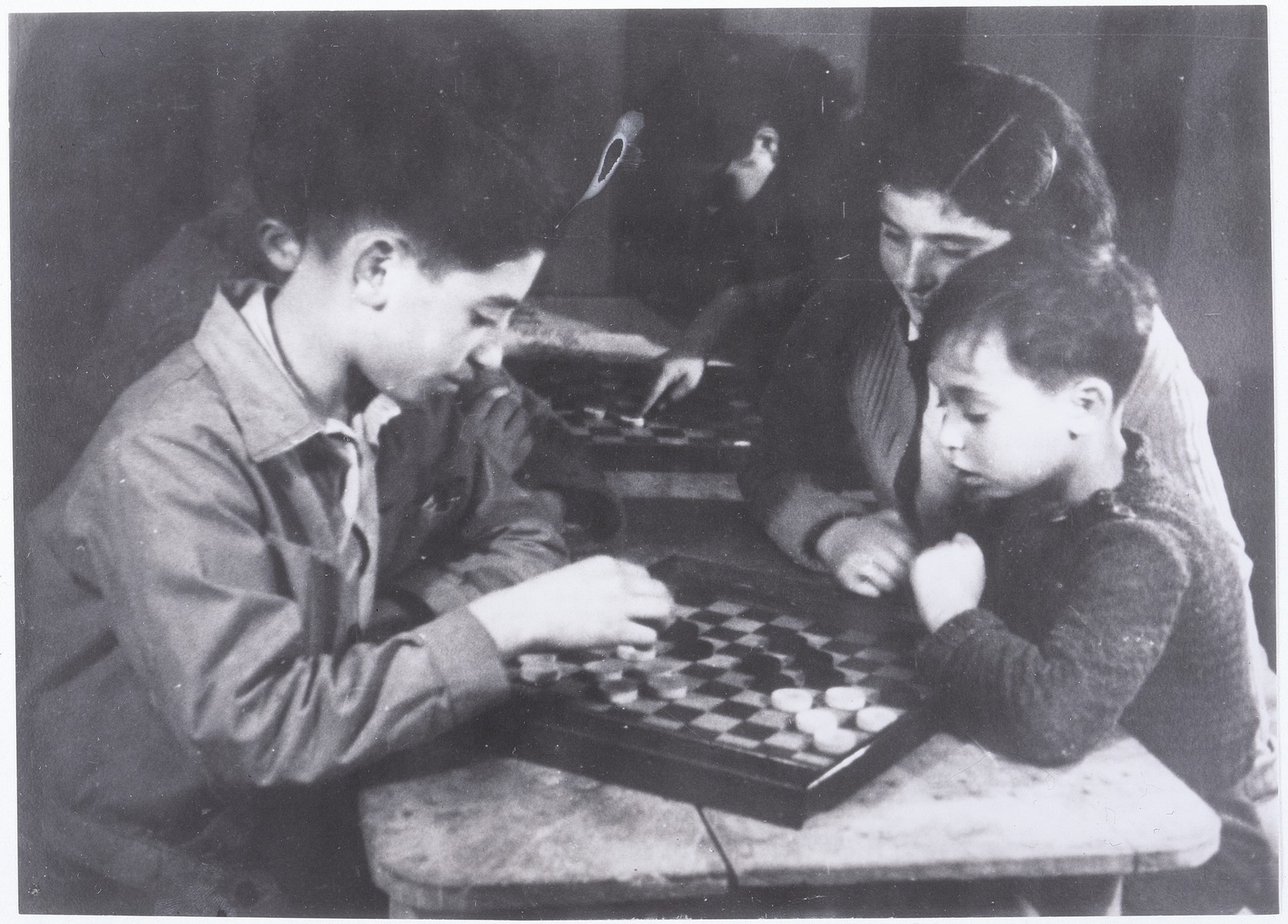 Simon and Michel Jeruchim play checkers in the home Cailly-sur-Eure near Evreux, Normandy, France.