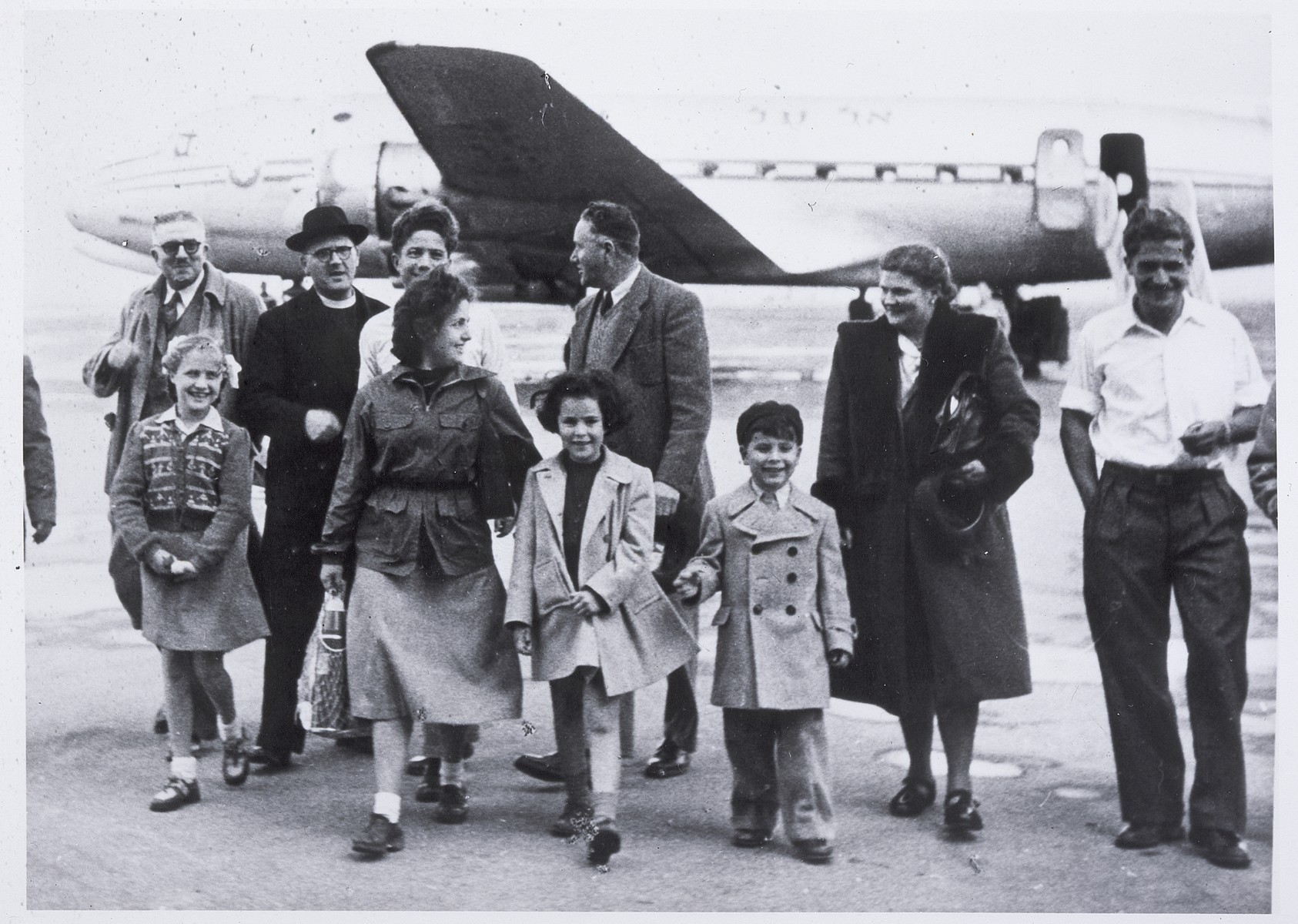 Father Louis Celis and Maria Tabruyn arrive at Lod Airport accompanied by the children they rescued: Regina, Wolfgang, Siegmund, and Sonja Rotenberg.