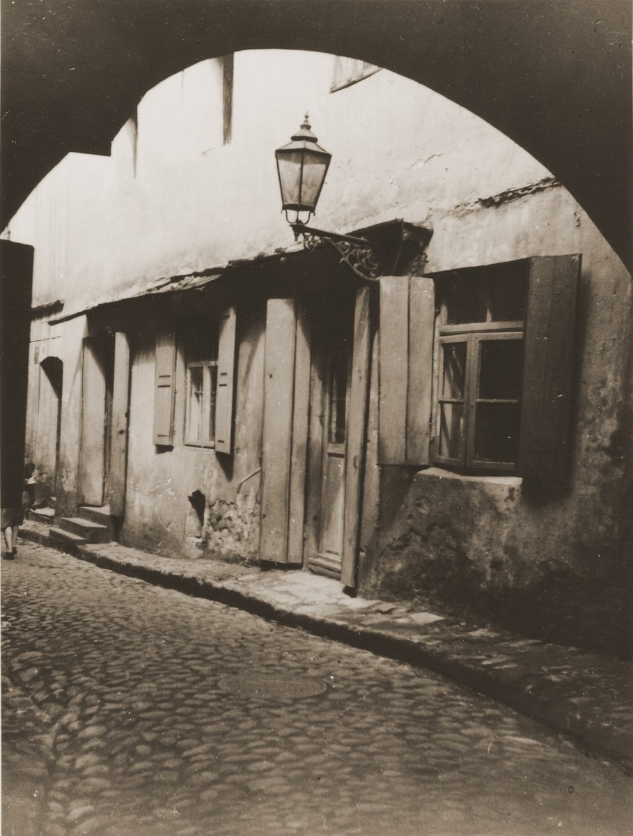 View of a street in the Lublin ghetto through an archway.