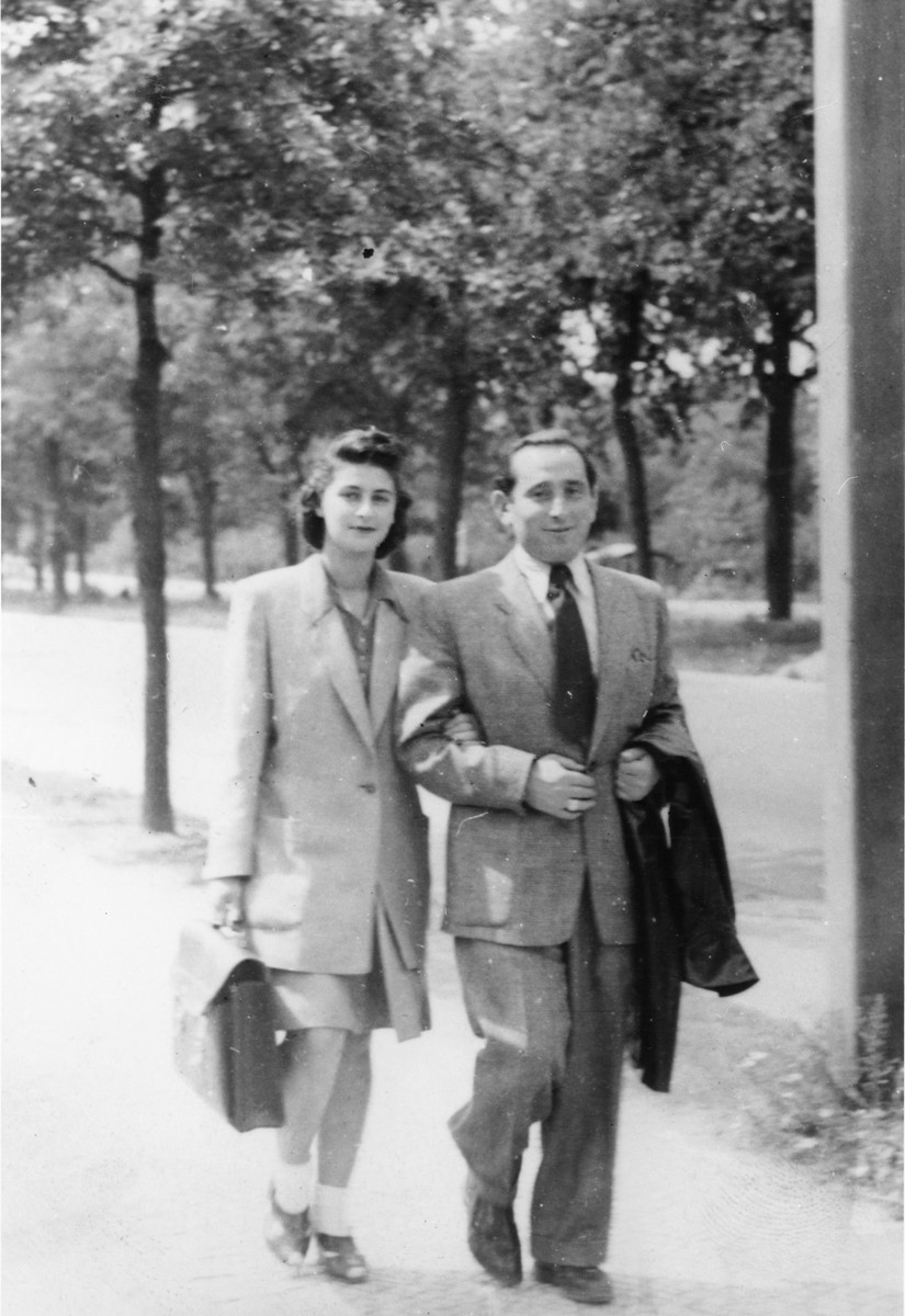 A young Jewish DP couple living at the Schlachtensee displaced persons camp, walks along a street in Berlin.  Pictured are Shmuel (Miles) and Rozalia (Krysia Laks) Lerman.