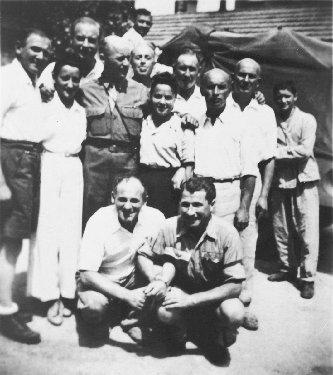 Group portrait of Jewish survivors (largely from the Kovno ghetto) at the St. Ottilien displaced persons hospital camp in Bavaria.  Among those pictured are survivor Michael Hofmekler (front left); his brother, U.S. serviceman Robert Hofmekler; Motel, Elia and Isaak Borstein; Henia Durmashkin (left) and Fania Durmashkin-Beiker (right)