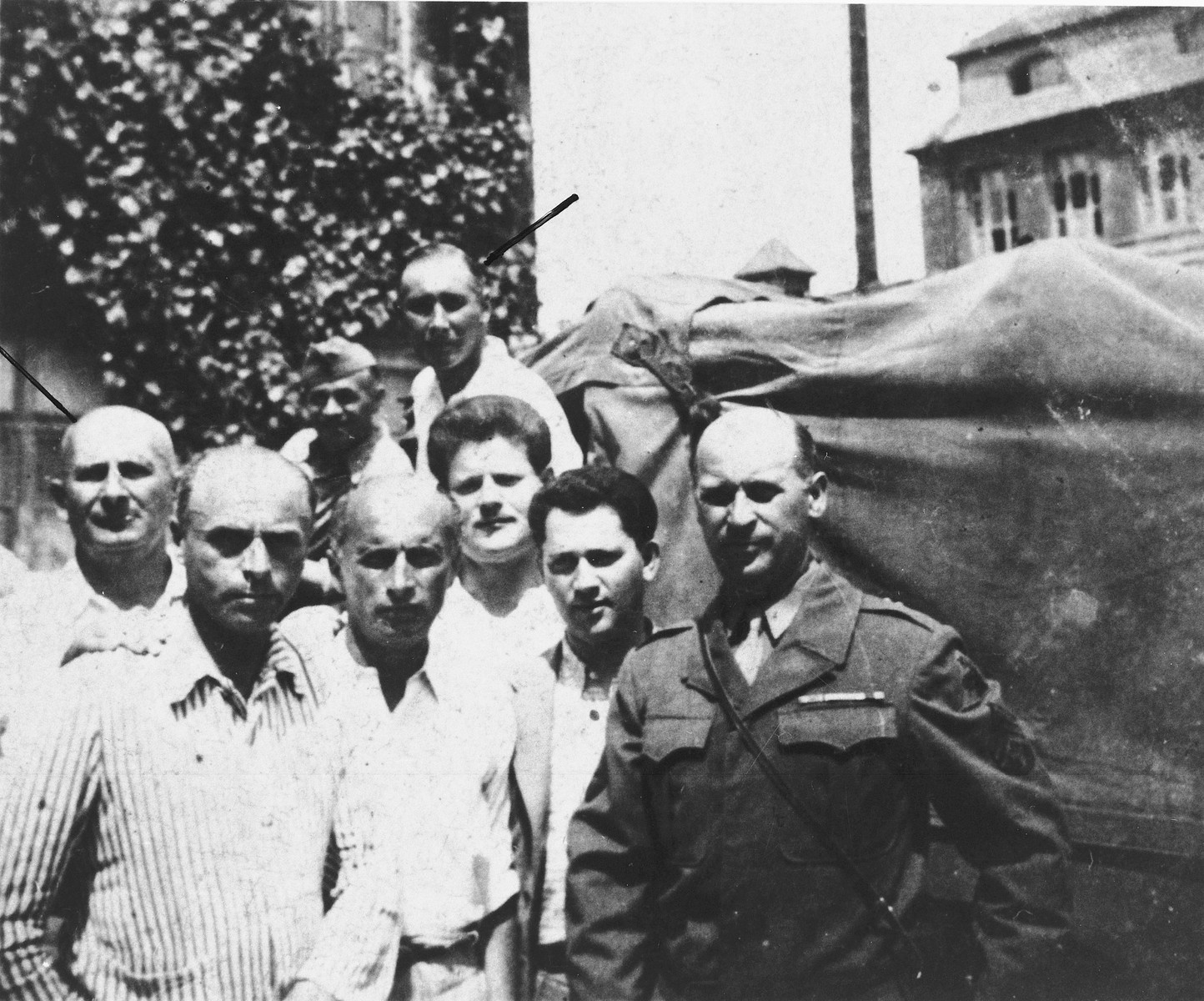 Group portrait of Jewish survivors (largely from the Kovno ghetto) at the St. Ottilien displaced persons hospital camp in Bavaria.  Among those pictured are Motel Borstein, violinist  in the St. Ottilien  Jewish Orchestra and the Ex-Concentration Camp Orchestra in Furstenfeldbruck (far left); his son Eli Borstein (back center); and Michael Hofmekler (front center).