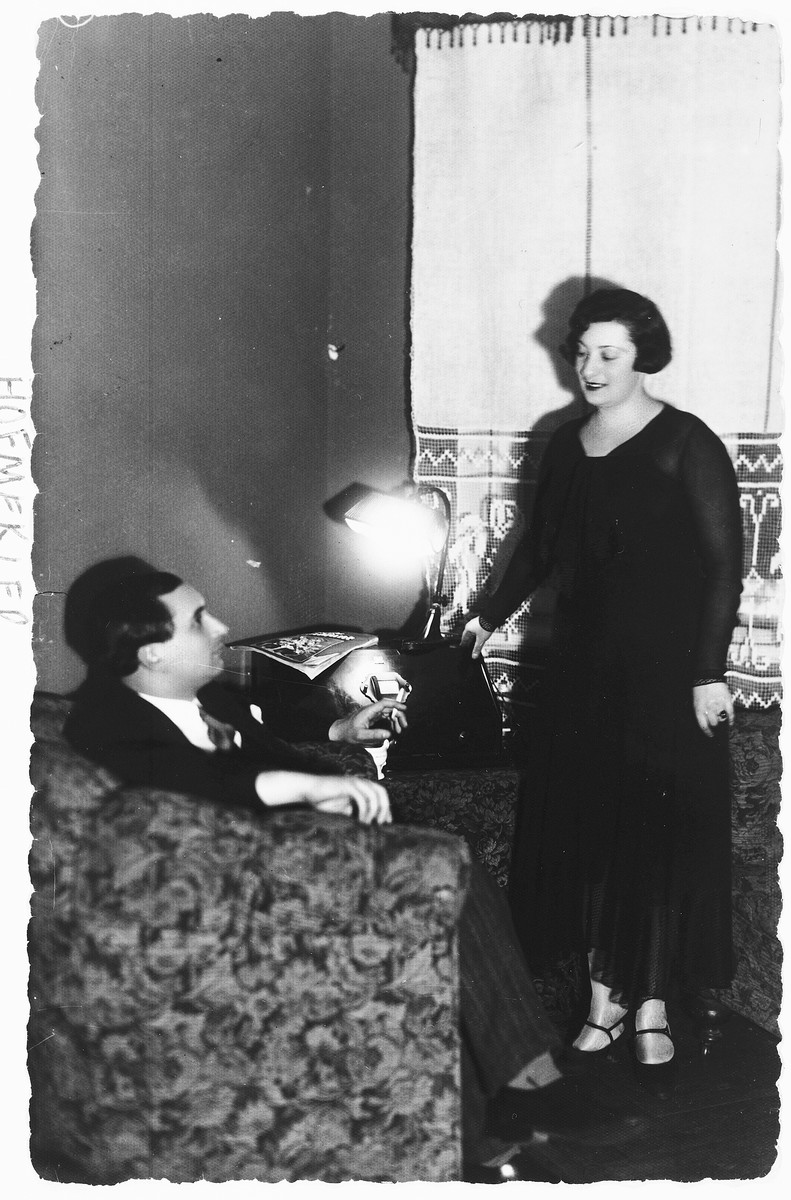 A Jewish couple in their home in Kovno, Lithuania.  Pictured are M. Leo and Sonya (Levin) Hofmekler.