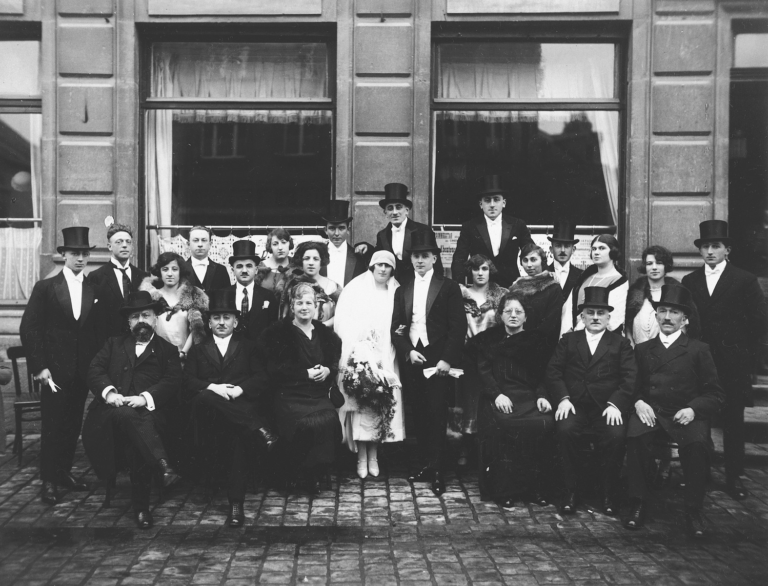 Group portrait of members of the Nussbaum wedding party at a Jewish marriage celebration in Luxembourg.