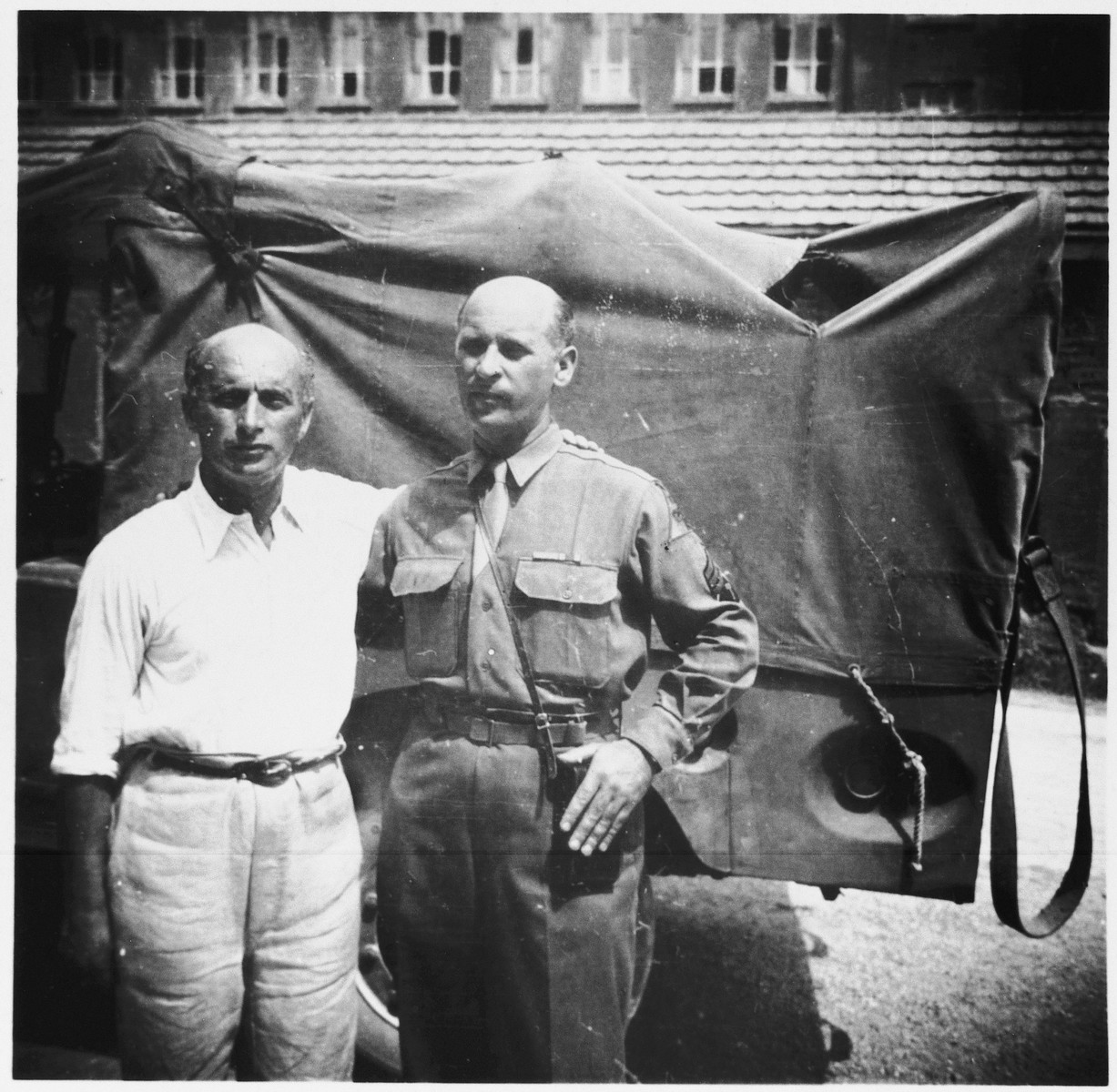 Portrait of two Jewish brothers on the day they found each other at the St. Ottilien displaced persons hospital camp in Bavaria.  Pictured are survivor Michael Hofmekler (left) and U.S. serviceman Robert Hofmekler (right).