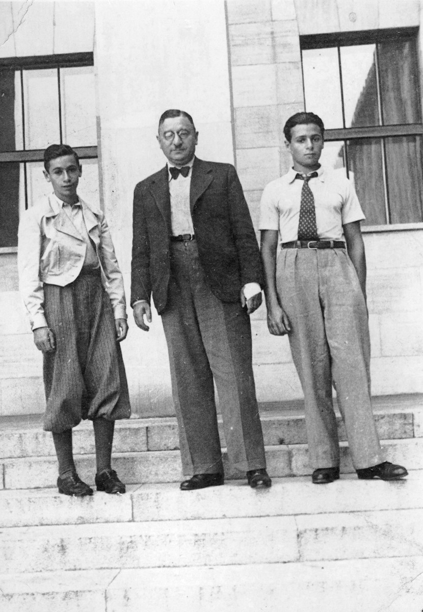 The Sedlis family stands on the steps of a building in Warsaw a few months before the start of World War II.  Pictured are Alexander, Elias and Gabriel Sedlis.