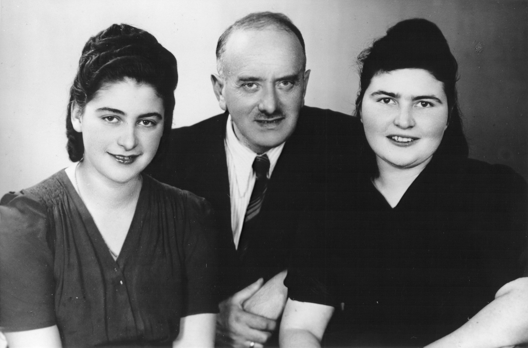 Group portrait of Jewish survivors in Lodz.  Pictured from left to right are: Rozalia Laks, her uncle Alexander Laks, and her cousin Anja Ptashnik.