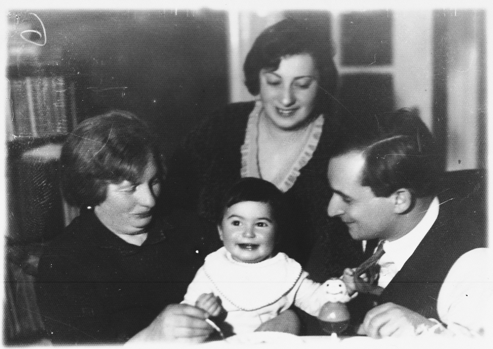 Portrait of the Hofmekler family in Kovno, Lithuania.  Pictured are Leon Hofmekler with his wife, Sonya, his son, Garrik, and Sonya's mother, Mrs. Levin