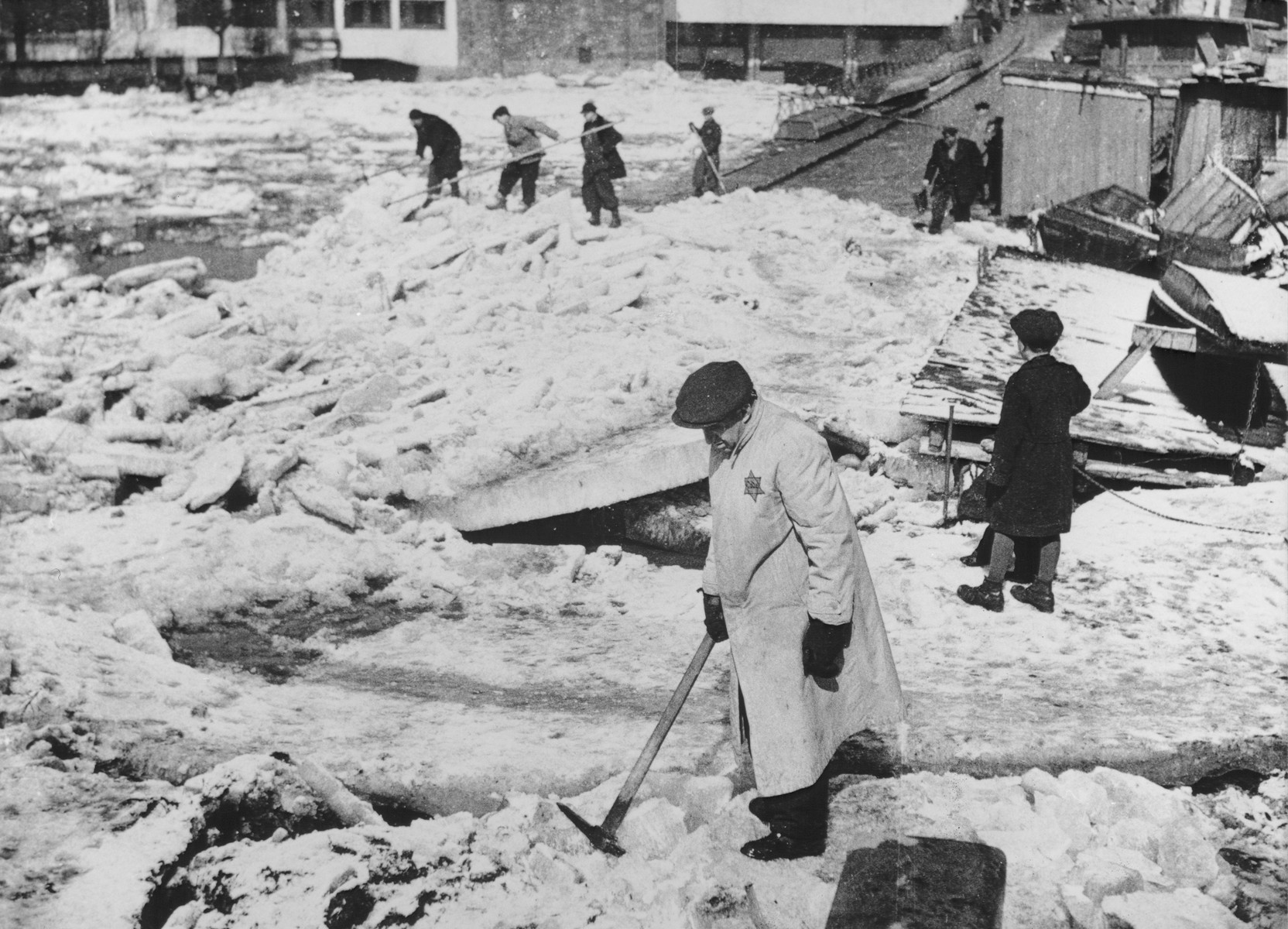 Czech Jews at forced labor clear ice in the center of Prague.