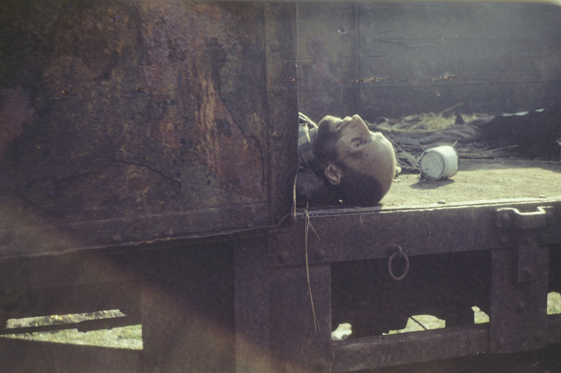 The body of a former inmate lies in an open railcar in the newly liberated Dachau concentration camp.