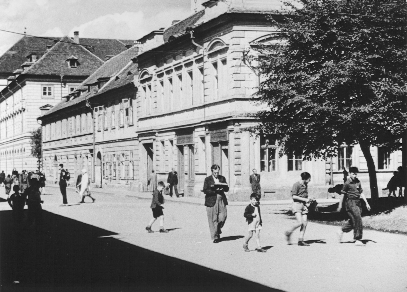 "STILL PHOTOGRAPH FROM THE NAZI PROPAGANDA FILM, ""Der Fuehrer Schenkt den Juden eine Stadt"" [The Fuehrer gives the Jews a City].  Street scene in Theresienstadt."