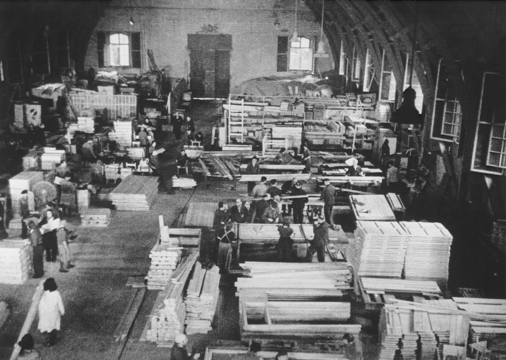 "STILL PHOTOGRAPH FROM THE NAZI PROPAGANDA FILM, ""Der Fuehrer Schenkt den Juden eine Stadt"" [The Fuehrer gives the Jews a City].  View from above of a woodworking factory in the Theresienstadt ghetto."