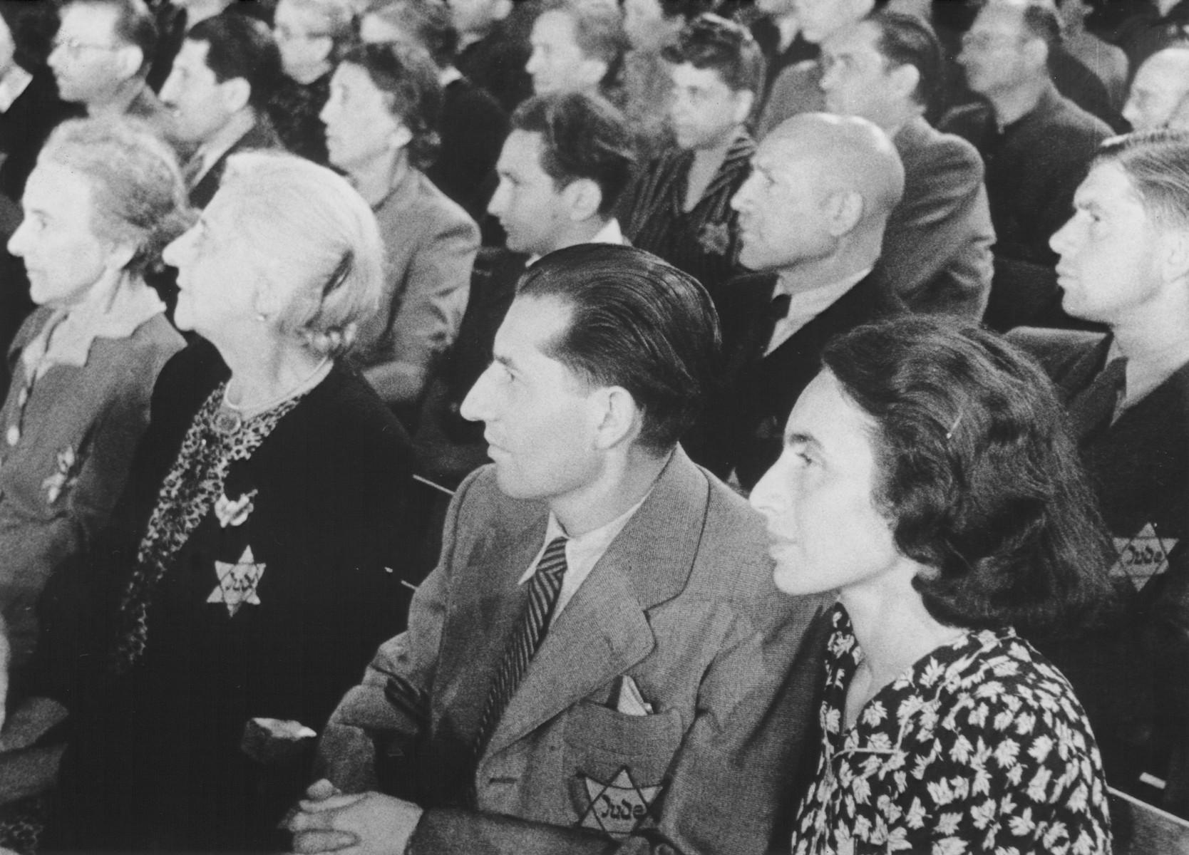 """STILL PHOTOGRAPH FROM THE NAZI PROPAGANDA FILM, """"Der Fuehrer Schenkt den Juden eine Stadt"""" [The Fuehrer gives the Jews a City].  Jews watching a performance in the Theresienstadt ghetto."""