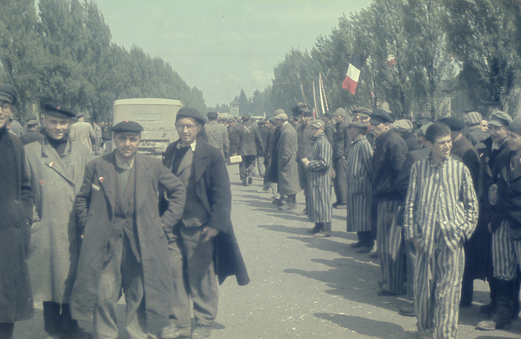 Former prisoners assemble on the main street in the newly liberated Dachau concentration camp.