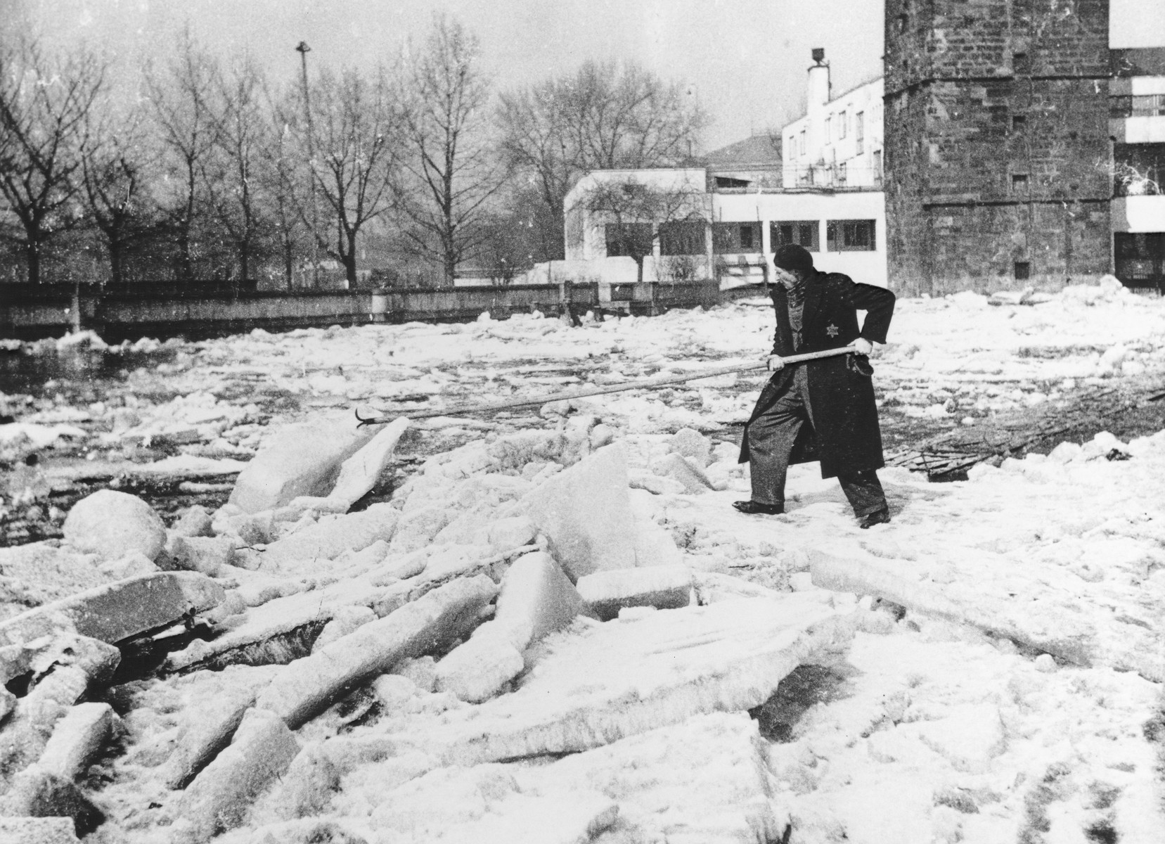 A Czech Jew at forced labor clears blocks of ice in the center of Prague.